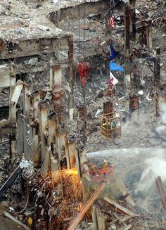 Workers continue to demolish the remains of the World Trade Center in New York, Wednesday afternoon Oct.