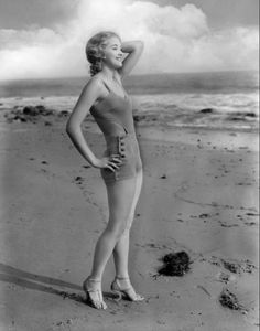 """Marian Marsh """"On the Pacific sands in a new bathing creation designed for swimming."""" June 24, 1931"""