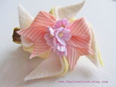 Baby/Girls Flower Hair Clip, Felt Hair Bow Clip, Pink Hair Bow with Flowers, Yellow and White Felt Pinwheel Hair Clip, Spring Hair Accessory. $8.95, via Etsy.