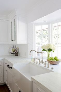 A gorgeous farmhouse sink is paired with an antique polished nickel faucet mounted in front of a bay window to a honed white marble countertop accenting white cabinets adorning oil rubbed bronze hardware. - My Interior Design Ideas Kitchen Cabinets Decor, Cabinet Decor, Cabinet Ideas, Cabinet Design, Cabinet Makeover, Kitchen Walls, Kitchen Hardware, Cabinet Drawers, Cabinet Handles