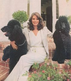 Jaclyn Smith with her Poodles