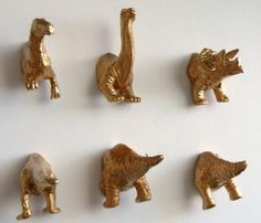 {Dinosaur Magnets} pretty cool idea - chop a plastic toy in 1/2, spraypaint, add magnets & voila!