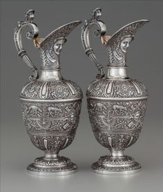 A Pair of John Samuel Hunt Victorian Cellini Pattern Partial Gilt Silver Wine Ewers, Hunt & Roskell, London, England, circa 1861