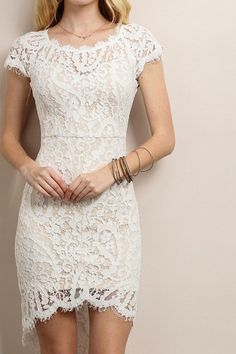 Sporting this white sheath dress is your first big score of the night, and each…