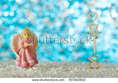Christmas card with angel. Snow drifts and figures 2018. Blurred background.