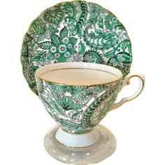 This stunning Bone China Teacup and Saucer is Royal Tuscan's Green Paisley pattern #D3267. The all-over green paisley chintz motif covers both the