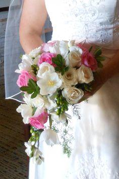 wedding flowers. bridal bouquet. cascade bouquet, white tulips, white roses, pink roses. http://thebloomingidea.blogspot.com