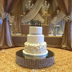 Nina&Navi 08 10 14 Fraserview Banquet Hall A vanilla raspberry cake with lemon buttercream and a soft white fondant finish. Dressed up in ruffled petals, and diamond imprint with embedded crystals. #sweettheacakes #weddingcake #wedding