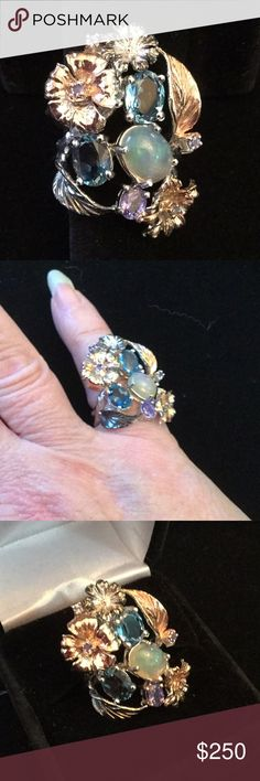 BREATHTAKING Genuine Topaz, Opal, Tanzanite Ring ! This is a one of a kind made by a master silversmith !  Genuine London Blue Topaz with a 🔥 Genuine Fire opal accented with Tanzanite.  All hand wrought sterling silver and a genuine rose gold and white gold overlay !  This work of art is special Gem Show Jewelry Rings