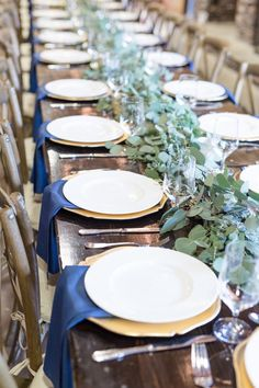 Mixed eucalyptus table garland, reception table greenery runner. Eucalyptus runner on long head table. Farm table greenery garland. Head table greenery garland. Navy and gold wedding. Florals: Wildflowers LLC, Photography: Lindsey Fisher #weddings, #green