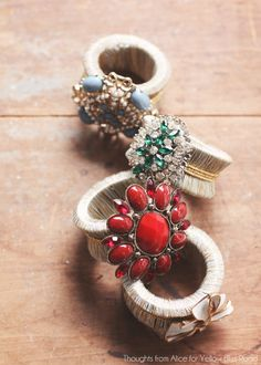 25+ Ways to Decorate with Affordable Vintage Finds | 9. Vintage Brooches Turned Glam Napkin Rings