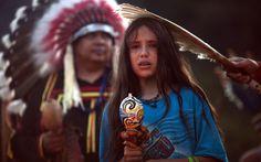 Xiuhtezcatl Martinez from the Azteca tribe participates in the fire lighting ceremonyPicture: Felipe Dana