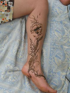floral tattoo on leg  may be able to take some inspiration from this for my leg tattoo, although not the design as a whole!