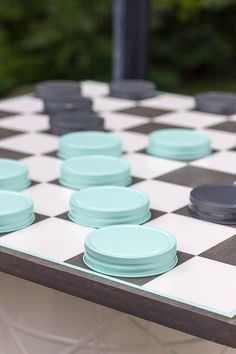 Make your own oversized checker board by reusing old lids.