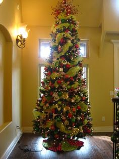 normally i hate skinny christmas trees but i think this one and its color scheme - Skinny Christmas Tree Decorating Ideas