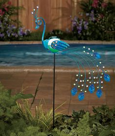 "Solar Metal Garden Birds - Peacock - 11.95 - 38""  3/2015 - solar quit soon - wings rusted 2016 - would get new but NA 10/2107"