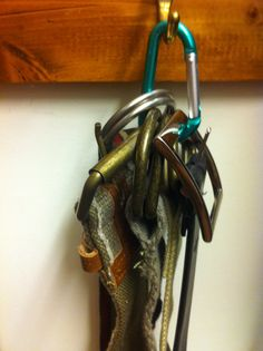 Use a carabiner to hang multiple belts on just one hook! A real space saver. #organization #home #diy #closet
