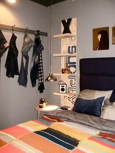 Mason loves plank shelves by bed  Hanging light is cool too