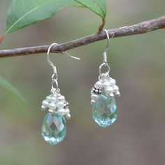 Sterling silver french wire earrings with 9mm x 14mm faceted light blue quartz tear drops and cultured freshwater pearls. Handmade in Austin, Texas. Includes a personally signed card by the designer who crafted the earrings.
