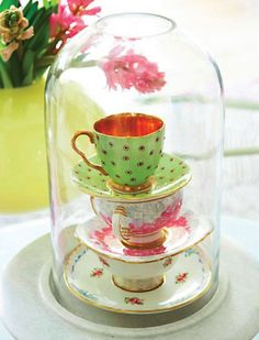 precious tea heirlooms protected in a glass keeper, discovered via ABCD Design via simplyseductive.blogspot.com