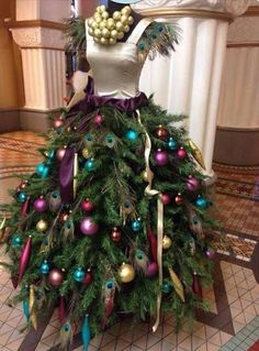 This mannequin gives way to a couture Chrstmas tree. Simply layer pine branches around the bottom and doll up your tree! Photo: Pinterest