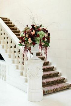 ceremony arrangements with cream, burgundy and blush in silver trumpet vases