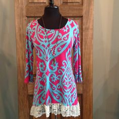 This top is like a breath of fresh air! Bright colors and just the right amount of lace!- 96% Polyester 4% Spandex- Loose Fit- Hand Wash- Made in the USA