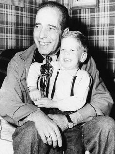 Humphrey Bogart with his son Stephen and his Oscar for The African Queen.