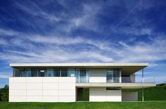 Stunning Ocean Guest House Wrapped in Fiber Cement Panels