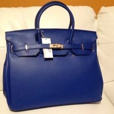 29847bc6ce1 I just discovered this while shopping on Poshmark  AUTHENTIC CARBOTTI  BIRKIN STYLE 40CM BAG W LOCK. Check it out! Size  40 CM