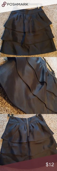 3 layer ruffle skirt Perf for holiday party, spiced up office outfit, or business social mixer. Tag says 0 but ideal for a size 6 to 8 ( i think it runs like chicos sizes) condition seems untouched. Etcetera Skirts