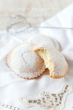 GENOVISI~ the shortcrust pastries filled with Sicilian lemon cream. They are made by Maria Grammatico in her famous Pasticceria in Erica, Sicily.