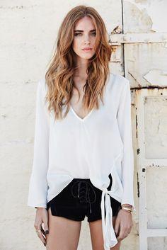 white blouse + black lace up shorts | The Blonde Salad