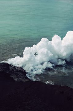 steam coming from the hot springs in underground caves which lead into the ocean's cold waters