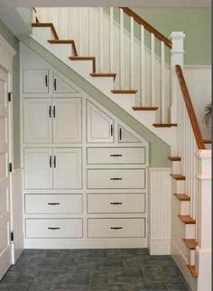 What to do with the space under the stairs.  Great way to use that awkward space and add super organized storage.
