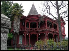 A rather spooky looking, but beautiful, old victorian house in Sonora, California. The deep red makes it look very imposing. Very cool, I think! I always wonder what stories it may tell !