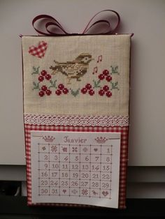 Lovely embroidered bird and berries, calender board