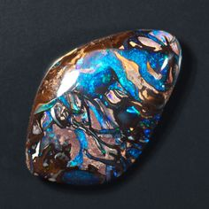 This is an Australian Boulder Opal (Black Opal + Iron/Sandstone), considered one of the most rare gems. These stones are usually found in volcanic regions. Opal Gemstone, Gemstone Colors, Opal Jewelry, Crystal Jewelry, Jewellery, Matrix Opal, Types Of Opals, Rocks And Gems, Blue Opal