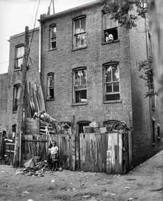 """1935. """"Row houses in Washington, D.C."""" Running the vertical gamut from natty to gritty. Harris & Ewing Collection glass negative."""