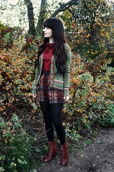 Plaid shorts, green cardigan, boots