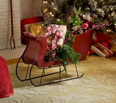 H206231 Red Sleigh will be a striking accent to your holiday decor.  http://qvc.co/-Shop-ValerieParrHill