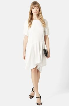 Free shipping and returns on Topshop Handkerchief Hem Dress at Nordstrom.com. Asymmetrical drop-waist styling falls into a floaty handkerchief hem on an ethereal short-sleeve dress designed to lightly skim the body.