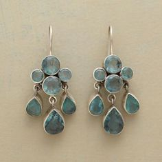 """Blue-green apatite teardrops dangle from a four-square of the same dusky gemstone. A Jane Diaz design with window-backed bezels affixed to French wires. Handmade in matte sterling silver. 1-1/2""""L."""