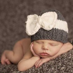 Just in! Sweet little hand knit bow beanie. Available in XS for newborns and Small for up to 1 year.