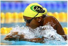 Jamaican Swimmer Alia Atkinson makes history by becoming the first black woman to win a world title in swimming.