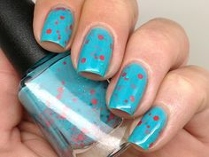 """Nail polish - """"The Fifth Element""""  turquoise and orange glitter in a turquoise blue base on Etsy, $10.15 CAD"""