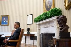 """A candid portrait of the President during a meeting, juxtaposed with the paintings of Abraham Lincoln and George Washington, busts of Martin Luther King, Jr., and Abraham Lincoln, and the Emancipation Proclamation. It's a difficult angle to get because I had to sit in front of the closed Oval Office door and hope that no one would open the door and knock me over."" (Official White House Photo by Pete Souza)"