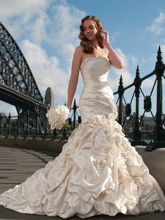 Glittering gems accent the trumpet silhouette of Sophia Tolli Y21240 Mirabelle Wedding Dress, trimming the strapless straight neckline crowning the richly ruched bodice. Enhanced with a corset back, the form-fitting top tapers through the thighs accented with matching embellishments.