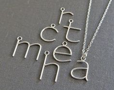 {S t y l e} Single initial necklace {M a t e r i a l s} Letter - Hand shaped Argentium* Sterling Silver wire with Argentium solder Chain - Sterling Silver flat cable chain with Sterling Silver lobster clasp and jump rings {L e t t e r . O p t i o n s} Available in A through Z and & (ampersand) symbol. Choose which initial you would like in the Letter drop-down box. {M e a s u r e m e n t s} Letter height: a, c, e, m, n, o, r, s, u, v, w, x, z = 1/2 (13mm) i = 9/16 (...