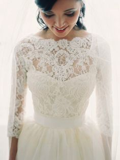 I love everything about this dress- the fitted lace stretching to the collar bone, the sweetheart neckline, the 3/4 length sleeves, the semi-high waist gathered with a sash and flowing out from there. Basically perfect!